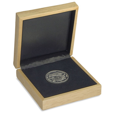 Case for storing coins made of pale wood